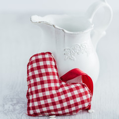 Red heart with milk jug