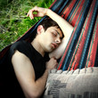 Young Man sleeping outdoor