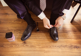 Young groom getting ready for wedding
