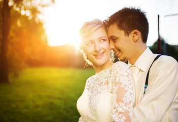 Young wedding couple on a summer meadow