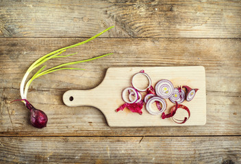 Chopped red onion on a wooden board