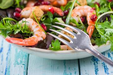 fork dig in fresh seafood salad with prawns