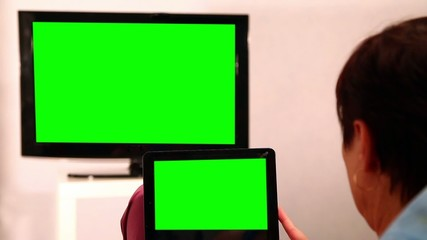 Woman With Green Screen Ipad Watches Tv