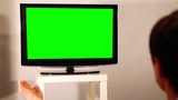 Surfing television channels.  TV green screen
