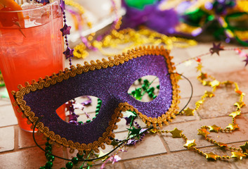 Mardi Gras: Party Mask Sits Against Tropical Hurricane Cocktail
