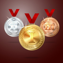 Vector Golden, Silver and Bronze medal set with red ribbons