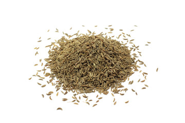 a handful of dried cumin seeds on a white background