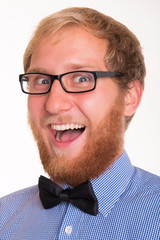 Portrait of happy bearded man with a bow tie