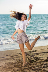 Young Woman in Funny Jump Shot at the Seaside.