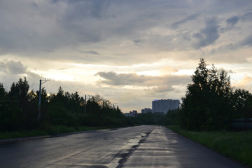 Road at cloudy dramatic sky.