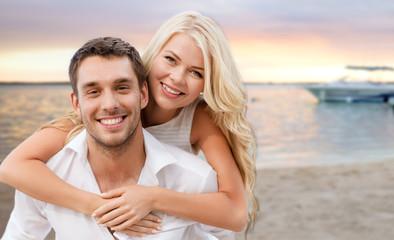 happy couple having fun over beach background