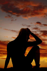 silhouette of a woman stressed sitting
