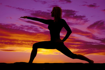 silhouette of woman lunge arm out