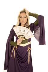 woman purple dress fan hand in hair looking