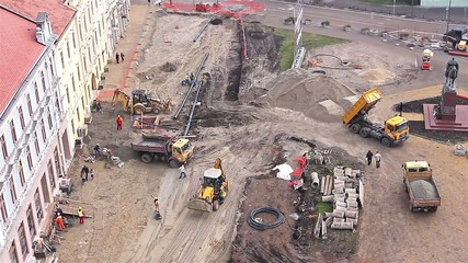 Aerial view of a construction site with workers and machinery