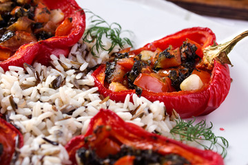 Roasted bell peppers stuffed with pesto and tomato