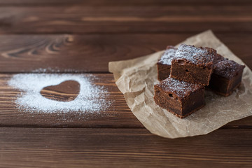 Chocolate brownie with powdered sugar heart