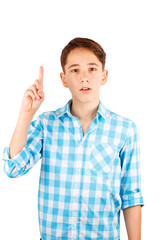 Surprised teen boy in plaid shirt staring at camera