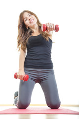 girl with weights or red dumbbells wearing sports clothing on ma