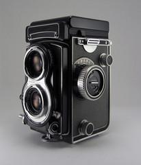 Cámara Fotográfica Antígua aislada en gris