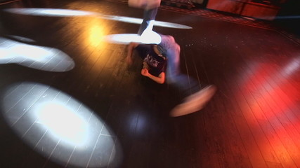 Hip-hop dancer  dances on stage in the club