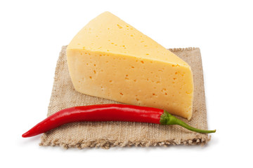 cheese and chili peppers on cloth