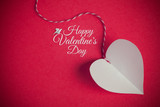 valentines day background with paper cut heart and message