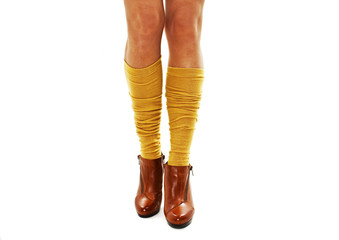 Beautiful woman legs in shoes and yellow socks