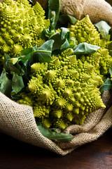 Romanesco broccoli cabbage on wood
