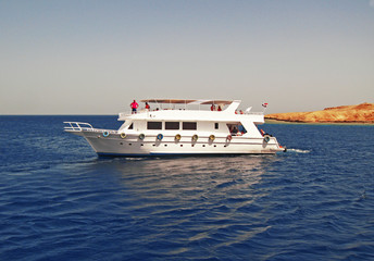 White Ship Moving By The Red Sea