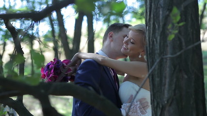 Bride and groom  kissing and smiling on their wedding day.