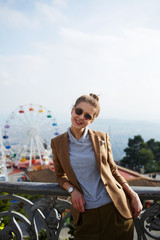 Young stylish woman posing outdoors for vacation photo