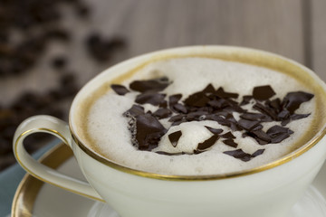 Cup of freshly brewed aromatic cappuccino espresso coffee