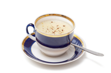 Ceramic cup of coffee with froth on white background