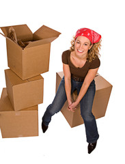 Boxes: Woman Sitting On Cardboard Box