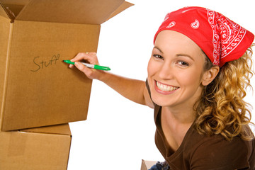 Boxes: Smiling Woman Writing On Box