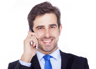 Handsome business man talking on the phone, isolated on a white