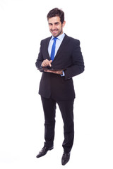 Handsome business man with tablet computer, isolated on a white