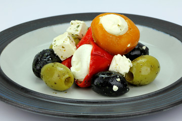 Peppers stuffed with cream cheese with olives.