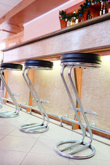 Chairs in row in bar