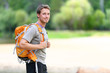 Hiking man portrait with backpack in nature