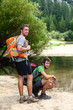 Hiking men resting after long hike in nature