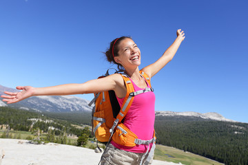 Happy hiker girl hiking carefree in nature