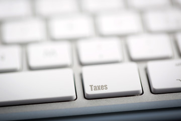 "The word ""TAXES"" written on keyboard"