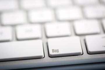 "The word ""BUG"" written on keyboard"