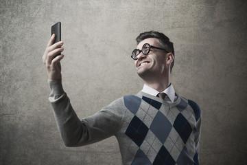 Funny guy taking a selfie