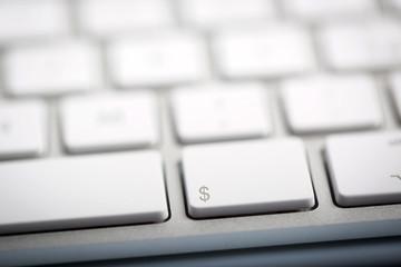 "The word ""DOLLAR"" written on keyboard"