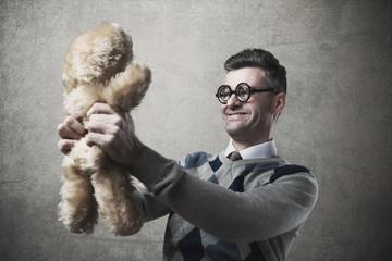 Guy holding a teddy bear