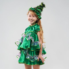 red-haired girl in costume Christmas trees