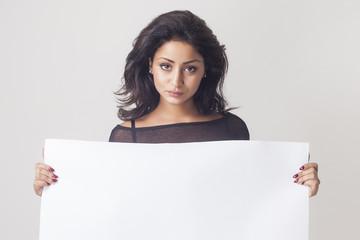 Woman holding white blank billboard closeup
